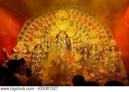 Kolkata, India - October 8th , 2019 : Hindu Priest Worshipping Goddess Durga With Sacred Lamp Under