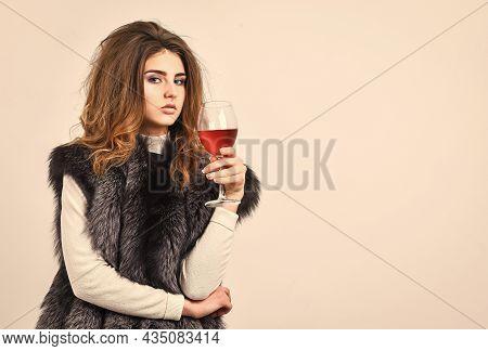 Fashion Model Long Hair Fur Coat Or Vest Hold Wineglass. Girl Enjoy Luxury Lifestyle Attributes. Wom