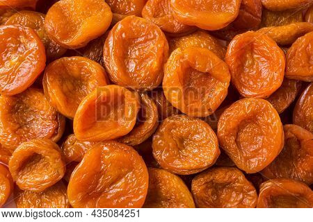 Dried Apricots. Background Of Dried Apricots. Dried Fruits Of Close Up. Top View. Background Of Drie