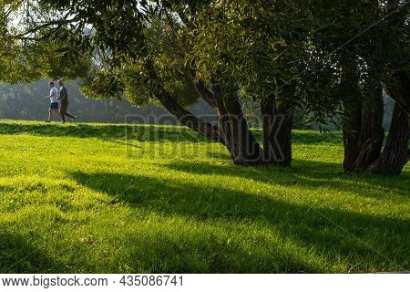 The City Of Suzdal, Vladimir Region, Russia-12.09.2021: Morning Jog Of Two Men In A Tourist Complex