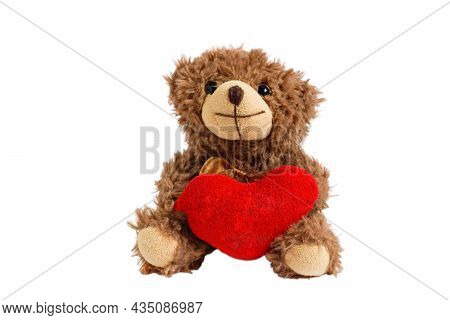 Teddy Bear Heart Isolated. Fluffy Stuffed Toy On A White Background Close-up. Teddy Bear With A Red