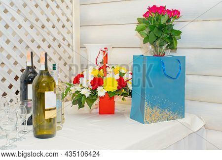 Celebratory Table With Flowers Boutique And Alcohol. Beautiful Bunch Of Flowers On The Table With Gl