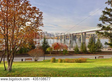 Metro Bridge On The Ob River. Autumn Embankment Of The Capital Of Siberia