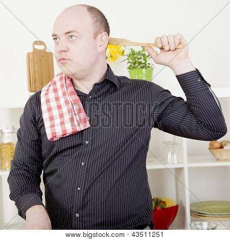 Man Lost In Thought While Cooking