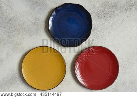 Set Of Colorful Ceramic Plates Flat Lay, Top View Of Clean Food Dish With Empty Space For Mock Up.