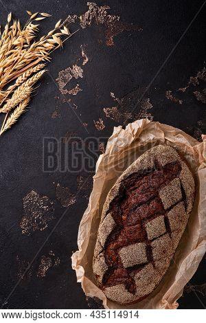 Freshly Baked Homemade Bread On Artisan Sourdough Rye On Brawn Stone Or Concrete Background. Top Vie