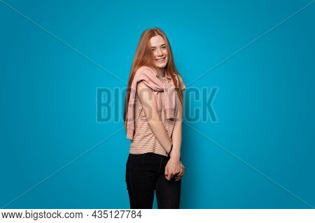 Woman With Ginger Hair And Freckles Posing On Blue Studio In Beautiful Style. Clean Fresh Skin. Beau