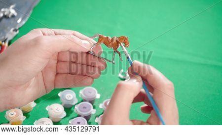 Image Of Craftsman Making Tin Horse At Home