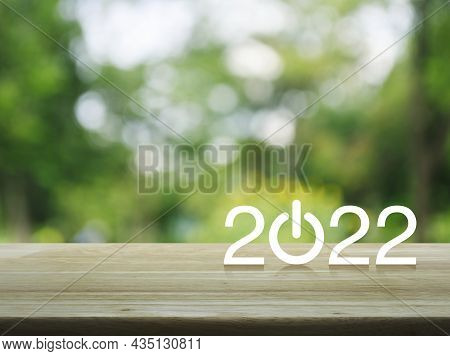 2022 Start Up Business Flat Icon On Wooden Table Over Blur Green Tree In Park, Happy New Year 2022 C