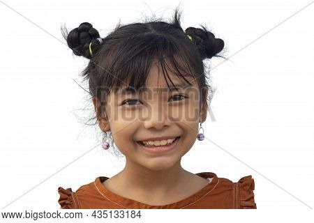 Portrait Of An Asian Little Girl Has Dark Two Hair Buns And Wearing Earring Looking Smiling At Camer