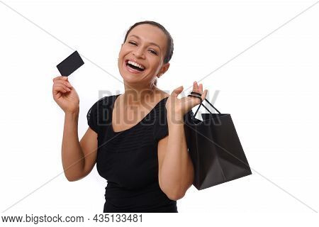Portrait Of Young African American Mixed Race Woman Smiling With Beautiful Toothy Smile Holding Shop