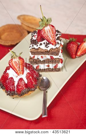 Strawberry Fruit Tart And Chocolate Strawberry Cake On A Plate