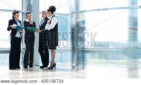Multi Ethnic Group Of Business Women In Office Lobby Of Modern Building, Female Coworkers And Commun