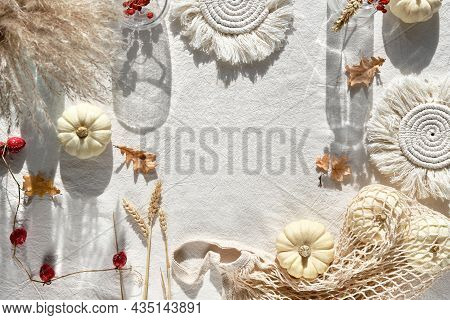 Off White Natural Fall Decorations With Copy-space. Flat Lay On White Textile, Place For Text. Pumpk