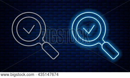 Glowing Neon Line Magnifying Glass With Check Mark Icon Isolated On Brick Wall Background. Search, F