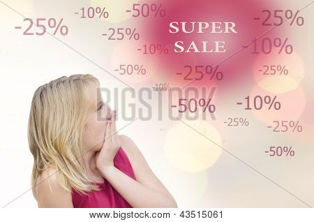 Surprised young blond Girl on white
