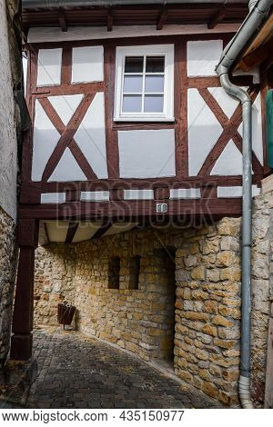 Cobblestone Alley With Half-timber House In Old Town Of Freinsheim, Rhineland-palatinate, Germany