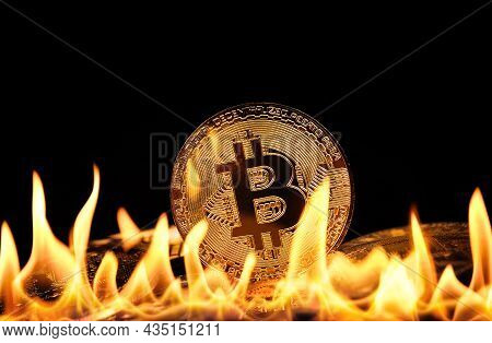 Close Up Heap Of Golden Bitcoin Physical Coins Burning In Fire Flames Over Black Background, As Symb