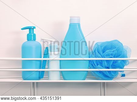Close Up Blue Bottles Of Beauty Care And Personal Hygiene Products, Man Shaving Set, On Bath Shelf O