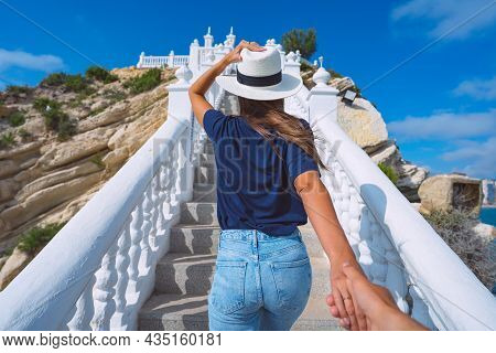 Young Tourist Woman In White Sun Hat Leading Man By Hand. Follow Me. Balcon Del Mediterraneo, Benido