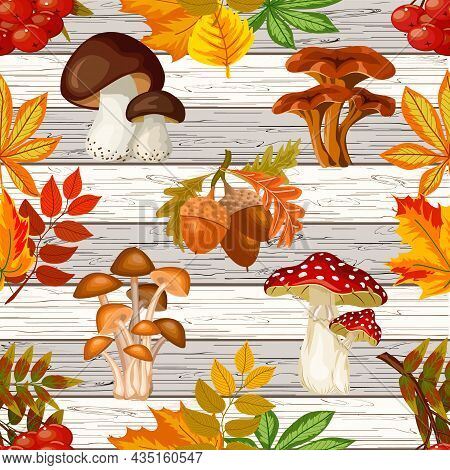 Mushrooms And Leaves On A Wooden Background.mushrooms And Autumn Leaves On A Wooden Background In A