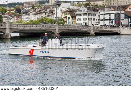 Zurich, Switzerland - June 12 2018: Two Police Officers Naviguating On The Limmat River.