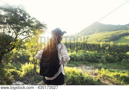 Asian Woman With A Backpack Enjoying The Sunset On The Top Of The Mountain Tourists On Simulator, Ba