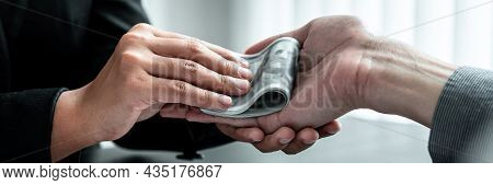 Business Woman Giving Bribe Money To Businessman To Bribing Deal Contract In A Corruption, Illegal,
