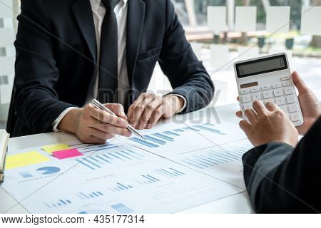Two Business Partner Team Meeting And Discussion Financial Project Of Investment Ideas, Presentation