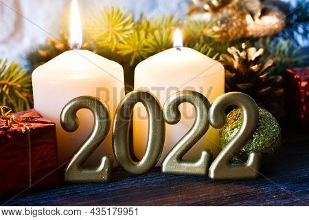 Happy New Years 2022. Christmas Background With Fir Tree Branches, Cones, Candles And Christmas Deco