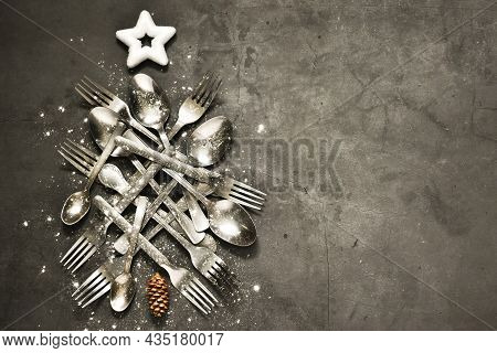 Christmas Tree Made Of Spoons And Forks With White Star On Top On A Gray Concrete Background. Top Vi