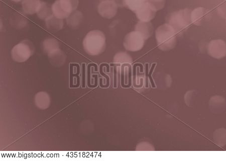 Bokeh background with dark dusty pink