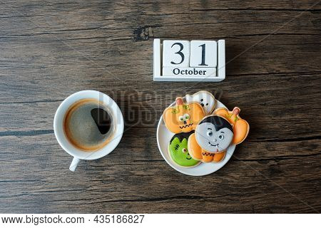 Happy Halloween Day With Cookies, Coffee And 31 October Calendar On White Background. Trick Or Threa