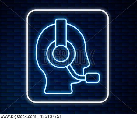 Glowing Neon Line Man With A Headset Icon Isolated On Brick Wall Background. Support Operator In Tou