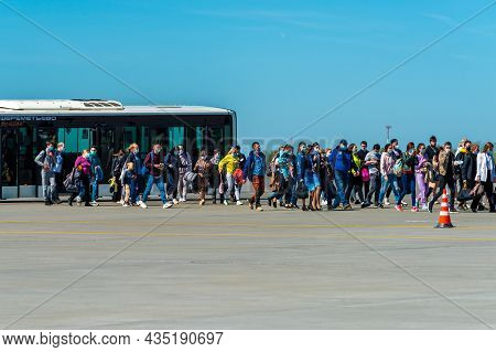 May 11, 2021, Moscow, Russia. Passengers Are Boarding The Plane On The Airfield Of The Sheremetyevo