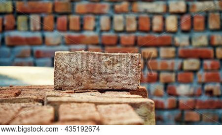 Close Up Shot Of Red Bricks. Construction Site Background. Brick Walls, And Door And Window Frames O