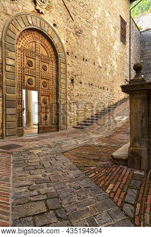 Games Of Light That Filters Through The Windows Inside The Palazzo Ducale In Gubbio, A Medieval City
