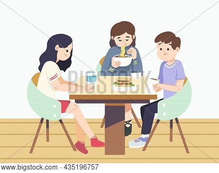 Friends Sitting Around Table At Cafe. Enjoying And Eating Meals. Sharing Drinks At Cafe. Indoor Cafe