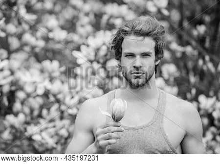 Man Flowers Background Defocused. Botany Nature. Male Beauty. Hipster Enjoy Blossom Aroma. Spring Be