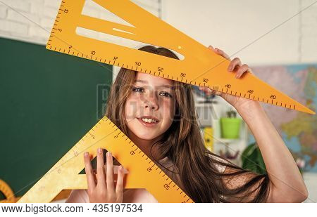 Cheerful Kid Learning Mathematics Subject. Modern Education. Knowledge Day. Child Pupil Hold Triangl