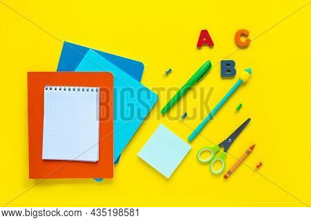 School Supplies On Yellow Background. Different Stationery With Blank Space On A Yellow Desk. View F