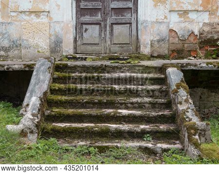 Destroyed Porch And Steps Of The Old Mansion. Ruined Entrance Of The Former Manor House