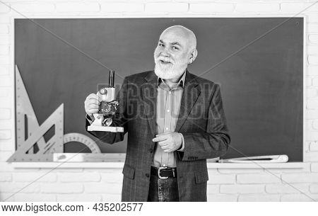 Man Bearded Tutor In Classroom. Mature Pedagogue Share His Knowledge. Stem Knowledge Is In Demand In