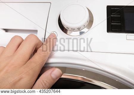 Female Hand Pushing Start Stop Button Of Washer, Washing Machine Cycle Interraption Or Starting, Beg