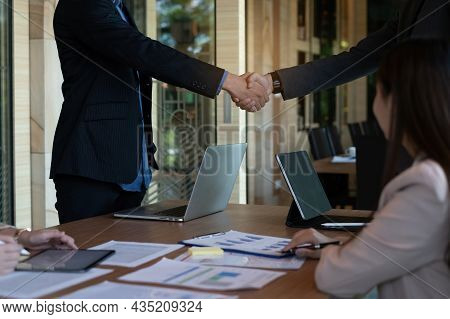 Businessman And Partner Handshake For The New Agreement After Sign In Agreement Contract With Work T