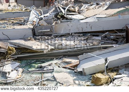 Building Debris Close-up. Demolition Of Buildings And Structures. Pieces Of Drywall, Glass And Steel