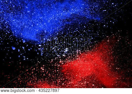 Blue And Red Color Powder Explosion On Black Background. Colored Cloud. Colorful Dust Explode. Paint
