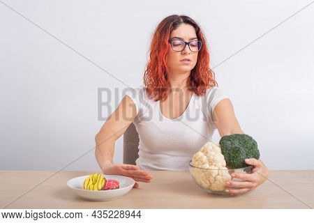 Caucasian Woman Prefers Healthy Food And Refuses Fast Food. Redhead Girl Chooses Between Broccoli An