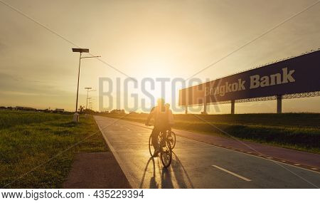 Samut Prakan, Thailand-june 18, 2021 : Sports Man Ride Bicycles On The Road In The Evening Near Bang