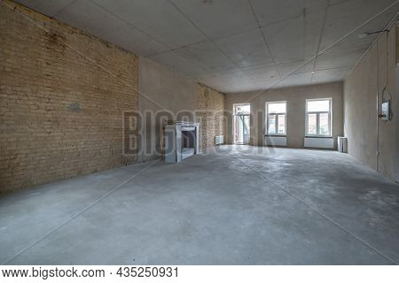 Empty Loft Room With Brick Wall And Repair And Without Furniture For Office